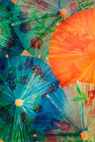 Close up of paper umbrellas with texture overlay