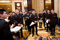 Shangri-La hotel waiters get ready to serve at the luncheon at Shanghai / Paris Europlace Financial Forum, in Shanghai, China, on December 1, 2010. Photo by Lucas Schifres/Pictobank