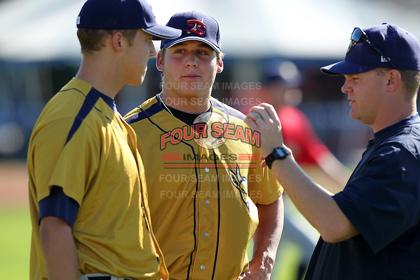 State College Spikes pitcher Stetson Allie (48 - center) and Jameson Taillon (43 - left) talk with pitching coach Mike Steele (31) before a game vs. the Batavia Muckdogs at Dwyer Stadium in Batavia, New York August 29, 2010.   Batavia defeated State College 6-4.  Photo By Mike Janes/Four Seam Images