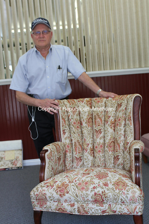 WATERTOWN, CT, 10 June 2015 - 061015LW03 - Ron Plourde shows off some of his handiwork at his new shop, Upholstery by Ron/ Fredricks at 737 Main St. in Watertown. Laraine Weschler Republican-American