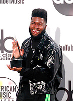 LOS ANGELES, CA - OCTOBER 09: Khalid, winner of the Favorite Male Artist - Soul/R&amp;B award, poses in the press room during the 2018 American Music Awards at Microsoft Theater on October 9, 2018 in Los Angeles, California. <br /> CAP/MPI/IS<br /> &copy;IS/MPI/Capital Pictures
