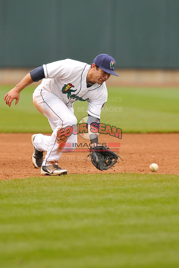 Joel Licon #2 of the Cedar Rapids Kernels fields a ground ball at shortstop against the Kane County Cougars at Perfect Game Field on May 1, 2014 in Cedar Rapids, Iowa. The Kernels won 5-2.   (Dennis Hubbard/Four Seam Images)