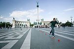 A young inline skater practices his moves at Hero's Square in Budapest, Hungary.