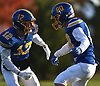 Matthew Mongelli #12 of Kellenberg, left, congratulates Sean Boll #80 after he caught a pass for a touchdown in the third quarter of the NYCHSFL Class AA final against Xavier (Manhattan) at Mitchel Athletic Complex in Uniondale on Saturday, Nov. 17, 2018. Kellenberg won by a score of 41-6.