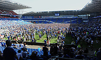 Cardiff City fans celebrate at the final whistle gaining promotion to the premier league<br /> <br /> Photographer Ian Cook/CameraSport<br /> <br /> The EFL Sky Bet Championship - Cardiff City v Reading - Sunday 6th May 2018 - Cardiff City Stadium - Cardiff<br /> <br /> World Copyright &copy; 2018 CameraSport. All rights reserved. 43 Linden Ave. Countesthorpe. Leicester. England. LE8 5PG - Tel: +44 (0) 116 277 4147 - admin@camerasport.com - www.camerasport.com