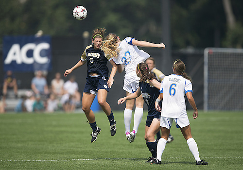 September 01, 2013:  Notre Dame forward Cari Roccaro (5) and UCLA midfielder Samantha Mewis (22) jump to head the ball during NCAA Soccer match between the Notre Dame Fighting Irish and the UCLA Bruins at Alumni Stadium in South Bend, Indiana.  UCLA defeated Notre Dame 1-0.