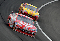 Feb 22, 2009; Fontana, CA, USA; NASCAR Sprint Cup Series driver Juan Pablo Montoya (42) leads Kevin Harvick during the Auto Club 500 at Auto Club Speedway. Mandatory Credit: Mark J. Rebilas-