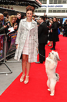"""Ashleigh and Pudsey arrives for the """"Postman Pat"""" premiere at the Odeon West End, Leicester Square, London. 11/05/2014 Picture by: Steve Vas / Featureflash"""