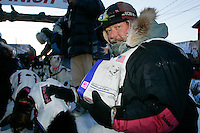 Thursday  March 15, 2007   ---- Nome, Alaska.   Rick Swenson is shown in Nome giving dog bone treats to his team moments after finishing the Iditarod in 26th place.