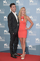 VENICE, ITALY - AUGUST 31: Actor Zac Efron and actress Maika Monroe attend the 'At Any Price' photocall during the 69th Venice Film Festival at the Palazzo del Casino on August 31, 2012 AFG / Mediapunchinc