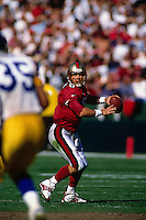 SAN FRANCISCO, CA - Quarterback Steve Young of the San Francisco 49ers in action during a game against the St. Louis Rams at Candlestick Park in San Francisco, California in 1997. Photo by Brad Mangin