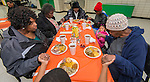 Sunnyside residents enjoy a Thanksgiving meal served by student volunteers at Worthing High School, November 23, 2013.