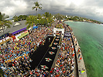 KONA-KAILUA, HI - OCTOBER 11: An aerial view of Sebastien Kienle of Germany crossing the finish line as the New World Champion at the 2014 IRONMAN Triathlon World Championships presented by GoPro on October 11, 2014 in Kailua-Kona, Hawaii. (Photo by Donald Miralle) *** Local Caption ***