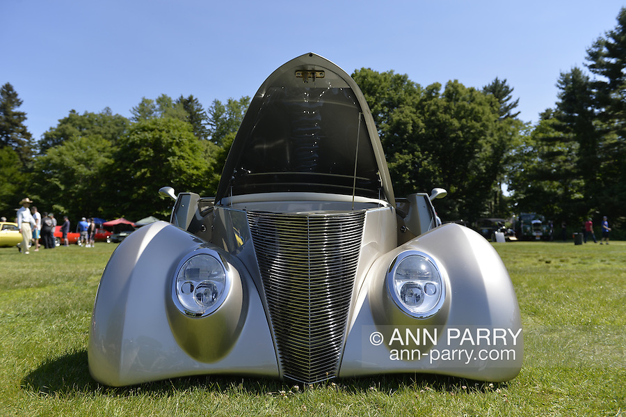 Old Westbury, New York, United States. 7th June 2015. An ultra low to the ground silver 1937 Ford, the First Place winner in the Modified Car category, participates at the 50th Annual Spring Meet Car Show sponsored by Greater New York Region Antique Automobile Club of America. Over 1,000 antique, classic, and custom cars participated at the popular Long Island vintage car show held at historic Old Westbury Gardens.