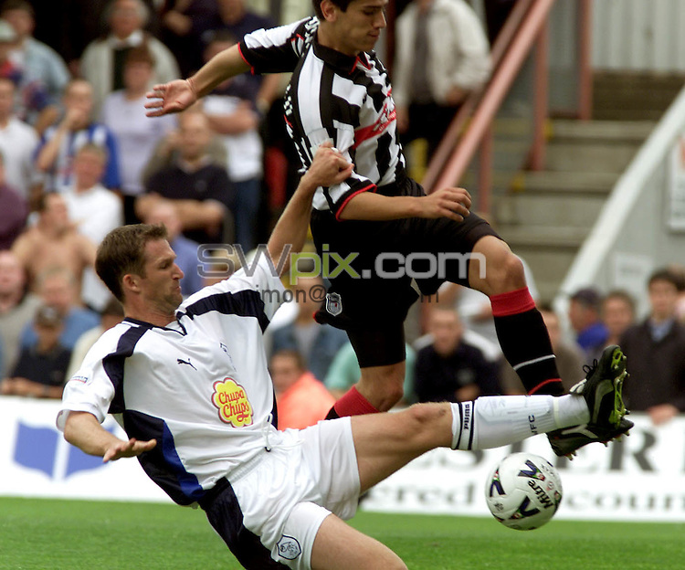 Pix, Shaun Flannery\SWPIX. Nationwide League Division 1.Grimsby Town v Sheffield Wednesday, 26/8/2000..COPYRIGHT PICTURE>>SIMON WILKINSON>>01943 - 436649>>..Sheffield's Simon Grayson challenges Grimsby's Michael Jeffrey.