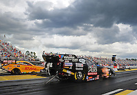 Mar. 9, 2012; Gainesville, FL, USA; NHRA funny car driver Blake Alexander (near lane) races alongside Jeff Arend during qualifying for the Gatornationals at Auto Plus Raceway at Gainesville. Mandatory Credit: Mark J. Rebilas-