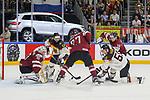 Deutschlands Hager, Patrick (Nr.50) und Deutschlands Schutz Felix (Nr.55)im Zweikampf mit Lettlands Cibulskis, Oskars (Nr.27) und Lettlands Galvins, Guntis (Nr.58) mit einer Chance gegen Lettlands Merzlikins, Elvis (Nr.30)  beim Spiel der IIHF 2017 WM, Deutschland - Lettland.<br /> <br /> Foto &copy; PIX-Sportfotos *** Foto ist honorarpflichtig! *** Auf Anfrage in hoeherer Qualitaet/Aufloesung. Belegexemplar erbeten. Veroeffentlichung ausschliesslich fuer journalistisch-publizistische Zwecke. For editorial use only.