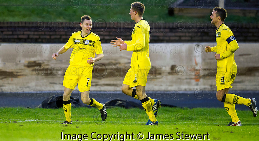 Queen of the South's Paul Burns (7) celebrates after he scores their first goal.