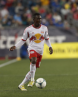 New York Red Bulls midfielder Lloyd Sam (10) controls the ball. In a Major League Soccer (MLS) match, the New England Revolution (blue) tied New York Red Bulls (white), 1-1, at Gillette Stadium on May 11, 2013.