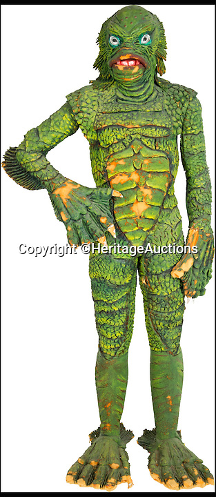 BNPS.co.uk (01202 558833)<br /> Pic: HeritageAuctions/BNPS<br /> <br /> A life-size film prop of the famous 1950s monster the Creature from the Black Lagoon that guarded its owner's office for decades is expected to fetch £24,000 at auction.<br /> <br /> The instantly-recognizable swamp beast frightened moviegoers in the 1950s, when the horror B movie was at its height.<br /> <br /> This Gill-man figure was made for the 1955 horror film Revenge of the Creature, the sequel to the 1954 cult classic Creature From the Black Lagoon.<br /> <br /> The unusual memorabilia was owned for about 40 years by Earl Jernigan, who worked as a grip - lighting and rigging technician - on the film when it was shot in North Central Florida and kept the monster after production finished.<br /> <br /> The prop will be sold by Heritage Auctions in Dallas, Texas on February 20.
