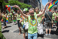 TD Bank employees in the annual Lesbian, Gay, Bisexual,Transgender and Queer (LGBTQ) Pride Parade on Fifth Avenue in New York on Sunday, June 25, 2017. Besides the corporate sponsors, politicians and various social service groups many participants carried political themed signs showing their dissatisfaction with President Trump. (© Richard B. Levine)