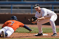 First baseman Austin Stadler #9 of the Wake Forest Demon Deacons catches a pick-off throw as John Barr #7 of the Virginia Cavaliers dives back into first base at Wake Forest Baseball Park March 8, 2009 in Winston-Salem, NC. (Photo by Brian Westerholt / Four Seam Images)