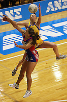 Mystics centre Temepara George and Pulse centre Camilla Lees compete for the ball during the ANZ Netball Championship match between the Central Pulse and Northern Mystics, TSB Bank Arena, Wellington, New Zealand on Monday, 4 May 2009. Photo: Dave Lintott / lintottphoto.co.nz