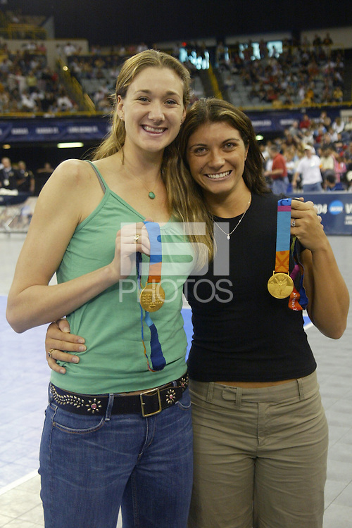 18 December 2004: Stanford Cardinal alum Kerri Walsh with Olympic gold medalist teammate Misty May during Stanford's  30-23, 30-27, 30-21 victory over Minnesota in the 2004 NCAA Women's Volleyball National Championships in Long Beach, CA. Stanford won their sixth women's volleyball title in school history.