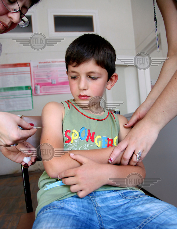 A health worker prepares to give an innoculation to a boy at Policlinic No 2.