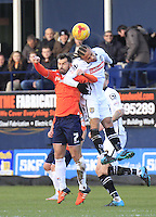 Curtis Thompson of Notts County beats Alex Lawless to the ball in the air during the Sky Bet League 2 match between Luton Town and Notts County at Kenilworth Road, Luton, England on 30 January 2016. Photo by Liam Smith.