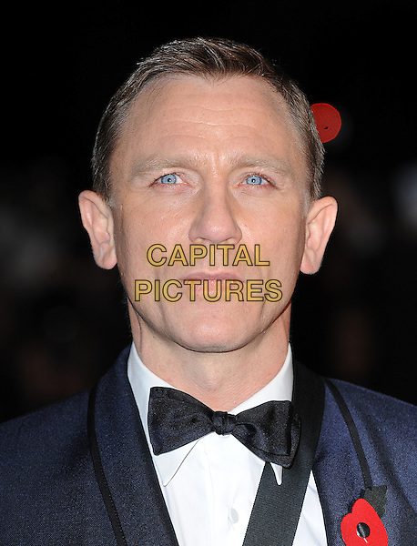 "DANIEL CRAIG.The Royal World Premiere of ""Quantum Of Solace"" at the Odeon Leicester Square, London, England. .October 29th 2008 .James Bond headshot portrait bow tie red flower poppy black white.CAP/BEL.©Tom Belcher/Capital Pictures."