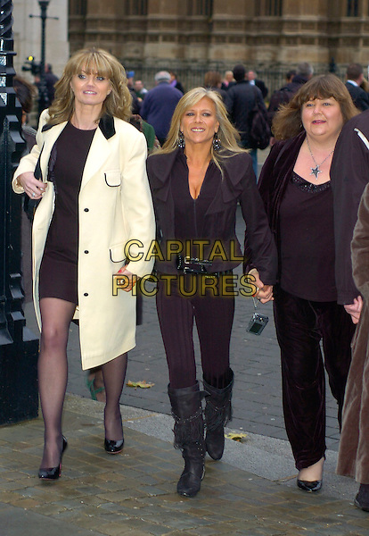 DANIELLA WESTBROOK, SAMANTHA FOX & CHERYL FERGISON.at The Woman's Own Children Of Courage Award, Westminster Abbey, London, England, UK, .December 10th 2009..full length dress coat suit trousers knee high boots holding hands walking Sam black ruffle folded collar jacket cream .CAP/DYL.©Dylan/Capital Pictures.