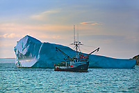 Iceberg and fishing boat returning from the Atlantic Ocean. Baie Verte Peninsula.<br />
