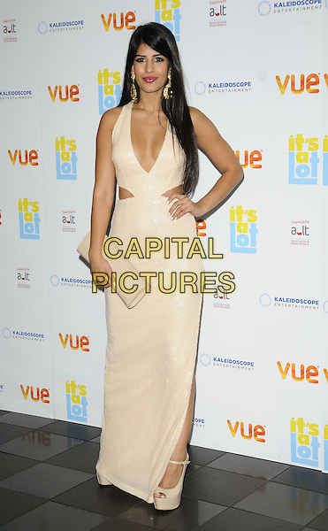 Jasmin Walia<br /> The &quot;It's A Lot&quot; UK film premiere, Vue West End cinema, Leicester Square, London, England.<br /> October 21st, 2013<br /> full length white dress slit split  cut out away cream cleavage low cut neckline clutch bag hand on hip<br /> CAP/CAN<br /> &copy;Can Nguyen/Capital Pictures