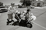 "pvc070114b/7-1-14/asec.  Allen Weaver (CQ, unusual spelling of first name), left, pushes a baby buggy carrying his eight year old daughter Mariah Weaver (CQ), right, and all of the family's posessions while crossing Third Street on their way to The Good Shepherd Center to collect mail, Monday June 30, 2014.  Allen said he, his wife Desiree Weaver (CQ), not pictured, and their daughter Mariah, have been without a home for over a year.  He said they stay in cheap motels, sleep on the streets or any place they can find.  Allen said ""We didn't want to be homeless. I got injured while working as a heavy equipment operator and lost my job.  Then we lost our apartment.  I have to panhandle to get money because there's no help for families that aren't doing drugs or are alcoholics.  We want a place for out family, a home.""  (Pat Vasquez-Cunningham/Journal)"