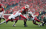 Indiana Hoosiers defensive backs Richard Council (6) and Chris Adkins (29) tackle Wisconsin Badgers running back James White (20) during an NCAA college football game on November 13, 2010 at Camp Randall Stadium in Madison, Wisconsin. The Badgers won 83-20. (Photo by David Stluka)
