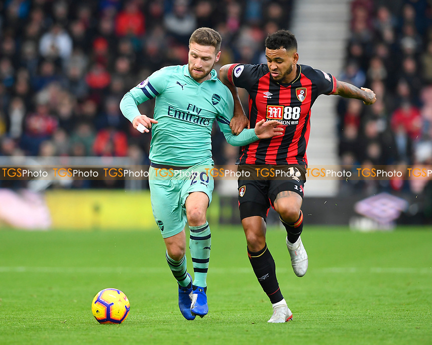 Shkodran Mustafi of Arsenal comes under pressure from Joshua King of AFC Bournemouth  during AFC Bournemouth vs Arsenal, Premier League Football at the Vitality Stadium on 25th November 2018