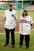 """Washington, D.C. - August 11, 2006 -- Former Negro Leagues players Al Burrows of the of the New York Black Yankees, left, and Mamie """"Peanut"""" Johnson of the Indanapolis Clowns, right, are introduced prior to the game between the visiting New York Mets and the Washington Nationals at RFK Stadium in Washington, D.C. on Friday, August 11, 2006.   In honor of Negro Leagues Appreciation Night, the teams are wearing the uniforms of the Homestead Grays (Nationals) and New York Cubans (Mets).  Ms. Johnson, a pitcher, is one of only 3 women to play in the Negro Leagues.  She compiled a 33 - 8 record with the Clowns.  Burrows and Johnson were Clowns  teammates in the 1950s.<br /> Credit: Ron Sachs / CNP<br /> (RESTRICTION: No New York Metro or other Newspapers within a 75 mile radius of New York City)"""