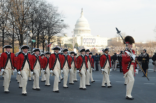 Washington, DC - January 20, 2009 -- The United States Army Old Guard Fife and Drum Corps march down Pennsylvania Avenue during the 2009 presidential inaugural parade in Washington, D.C., Tuesday, January 20, 2009.  More than 5,000 men and women in uniform are providing military ceremonial support to the presidential inauguration, a tradition dating back to George Washington's 1789 inauguration. .Credit: Mark O'Donald - DoD via CNP