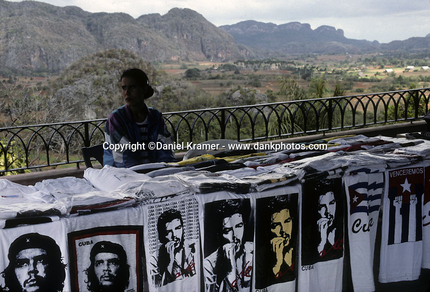 A woman sells t-shirts at a roadside stand in Western Cuba in 1999.