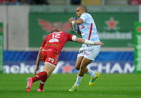 Racing 92 Simon Zebo is tackled by Scarlets' Hadleigh Parkes<br /> <br /> Photographer Ian Cook/CameraSport<br /> <br /> European Rugby Champions Cup - Scarlets v Racing 92 - Saturday 13th October 2018 - Parc y Scarlets - Llanelli<br /> <br /> World Copyright &copy; 2018 CameraSport. All rights reserved. 43 Linden Ave. Countesthorpe. Leicester. England. LE8 5PG - Tel: +44 (0) 116 277 4147 - admin@camerasport.com - www.camerasport.com