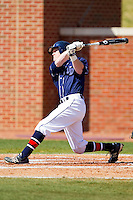 Josh Jeffery #5 of the Dayton Flyers follows through on his swing against the High Point Panthers at Willard Stadium on February 26, 2012 in High Point, North Carolina.    (Brian Westerholt / Four Seam Images)