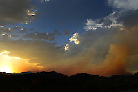 Aug. 14, 2012; Desert mountain sunset sky fire cloud wildfire smoke Mandatory Credit: Mark J. Rebilas