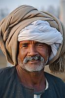 Portrait of Egyptian camel trader, camel market, Cairo, Egypt