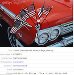 1960'S CHEVROLET WITH AMERICAN FLAGES CLOSE UP