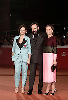 French actress Juliette Binoche (L), British actor Ralph Fiennes (C) and British actress Kristin Scott Thomas (R), pose on the red carpet as they arrive for a special screening of the movie &quot;The English Patient&quot; during the international Rome Film Festival at Rome's Auditorium, 22 October 2016. The Film Festival celebrates one of the most beloved of Cinema History 'The English Patient' by Anthony Minghella, released twenty years ago (in 1996). <br /> UPDATE IMAGES PRESS/Isabella Bonotto