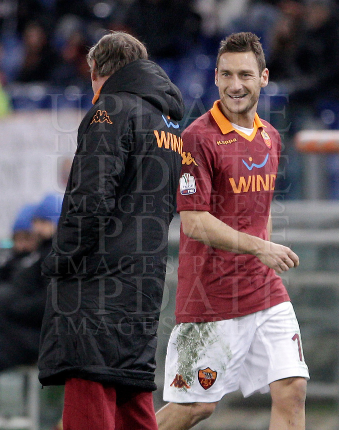 Calcio, semifinale di andata di Coppa Italia: Roma vs Inter. Roma, stadio Olimpico, 23 gennaio 2013..AS Roma forward Francesco Totti, right smiles to coach Zdenek Zeman, of Czech Republic, as he leaves the pitch during the Italy Cup football semifinal first half match between AS Roma and FC Inter at Rome's Olympic stadium, 23 January 2013..UPDATE IMAGES PRESS/Riccardo De Luca