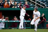 Head Coach Keith Guttin (2) of the Missouri State Bears signals Luke Voit (30) around third base after a base hit by Brock Chaffin (25) during a game against the Oklahoma State Cowboys at Hammons Field on March 6, 2012 in Springfield, Missouri. (David Welker / Four Seam Images)