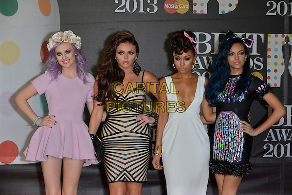 Little Mix (Perrie Edwards, Jesy Nelson, Leigh-Anne Pinnock and Jade Thirlwall).The Brit Awards 2013 arrivals at the O2, Greenwich, London, England 20th February 2013.The Brits half length band girl group pink white dress  purple hair flowers garland dyed hand on hip  black nude patterned low cut plunging neckline  bow .CAP/PL.©Phil Loftus/Capital Pictures.