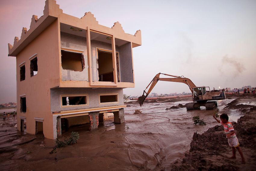 A mixture of sand and water inundates the lower floor of a building on the northwestern edge of Boeung Kak lake, December 25, 2010.